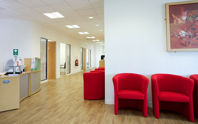 Red chairs in a waiting room