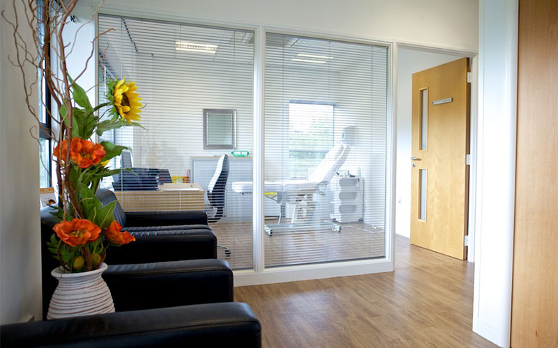Double glazed office partition with integral blinds.